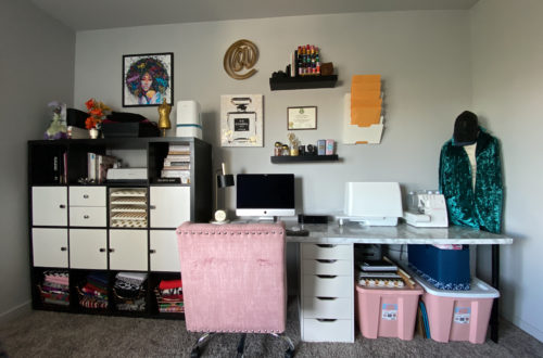 Image of a black and gold office with a pink chair and storage bins